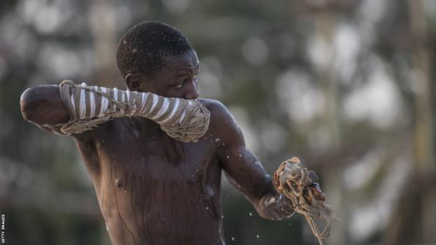 A young Dambe boxer covers himself with water after a fight in the Dambe Warriors Tournament held in Lagos on March 2, 2018. Dambe, a brutal style of fighting where one wrapped fist is a designated spear and the other a shield, is traditionally practised by Hausas in Nigeria's north, but on this night the fight was in the southern city of Lagos. The attempt to introduce Dambe to the megacity's elite was notable less for the fighting than as a showcase of Nigeria's complexity.