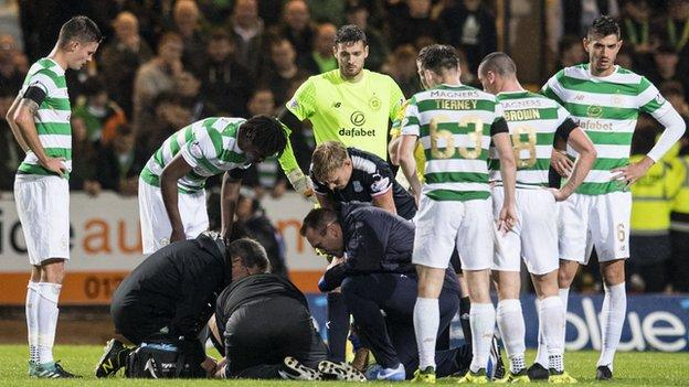 Dundee midfielder Randy Wolters receives treatment against Celtic