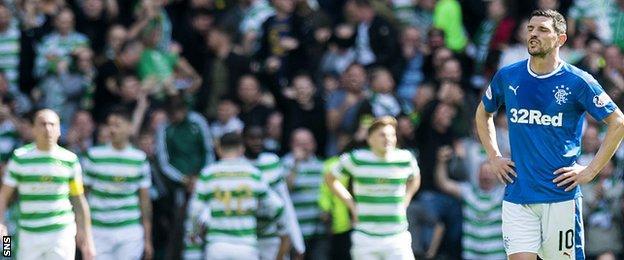 Rangers midfielder Graham Dorrans is left dejected against Celtic