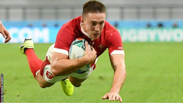 Josh Adams dives over for Wales' third try