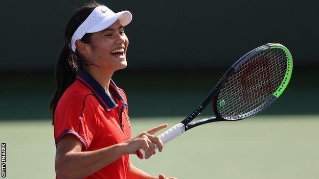 Emma Raducanu laughing during practice.