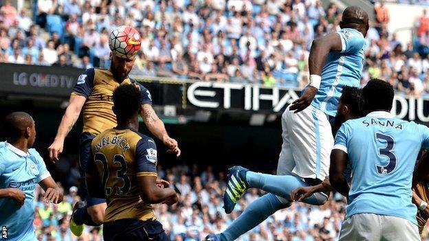 Eliaquim Mangala sees Olivier Giroud head the ball