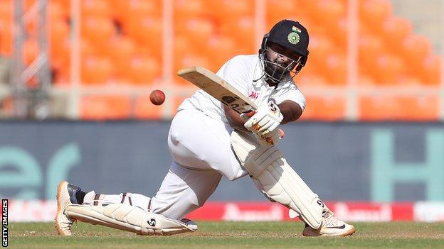 India batsman Rishabh Pant plays a sweep shot on day two of the final Test against England