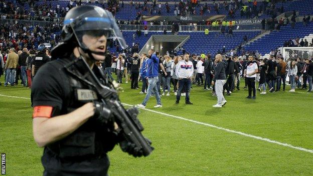 Police tried to control matters on the pitch as fans left the stands