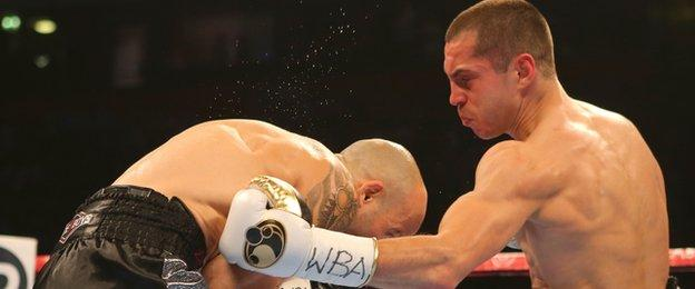 Bury fighter Scott Quigg lands a body punch in the brief contest with Kiko Martinez