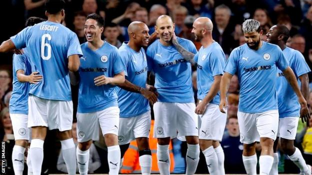 City celebrated taking the lead early on when Martin Petrov (centre) found the net
