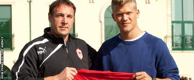 Malky Mackay (left) with Andreas Cornelius