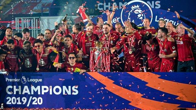 Liverpool's players celebrate as they lift the Premier League trophy  What is the big picture for English football after turbulent week?| Daily's Flash  113579733 hi062587208  What is the big picture for English football after turbulent week?| Daily's Flash  113579733 hi062587208