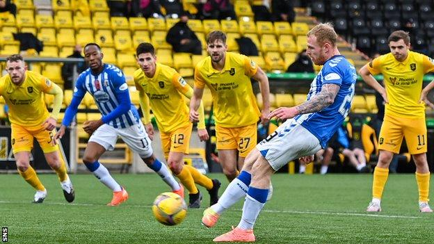 Chris Burke scores a penalty to give Kilmarnock the lead before half-time