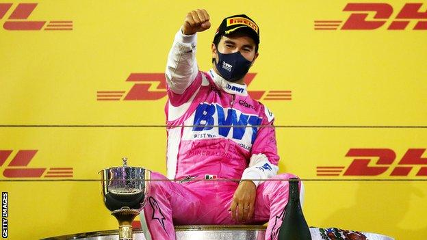 Racing Point driver Sergio Perez celebrates on the podium after winning the 2020 Sakhir race in Bahrain