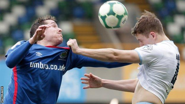 Linfield's Marek Cervenka competes with Ballymena defender Jonathan Addis
