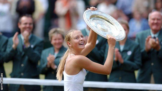 Maria Sharapova holds up the Venus Rosewater Dish on Centre Court after winning Wimbledon in 2004