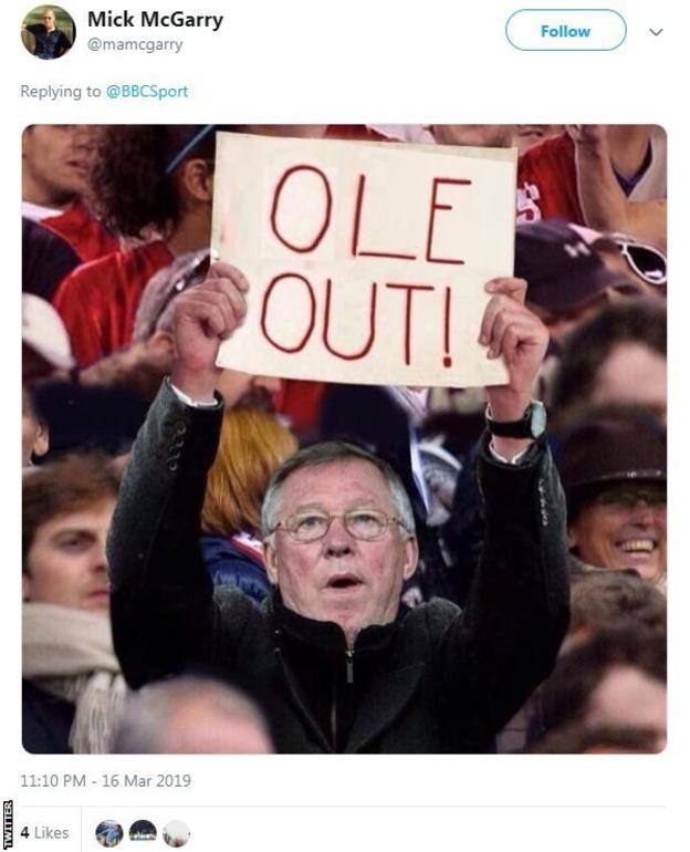 Tweet of Sir Alex Ferguson holding up 'Ole out' banner