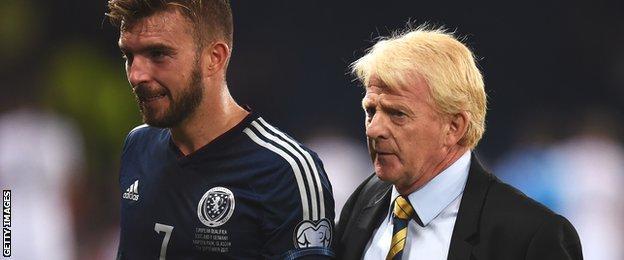 James Morrison trudges off the Hampden pitch beside Scotland manager Gordon Strachan