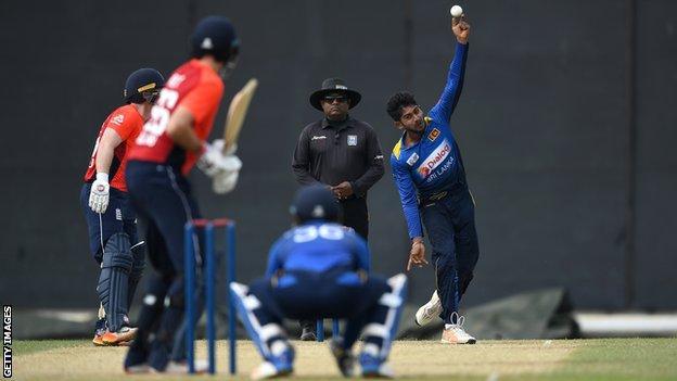 Sri Lanka's Kamindu Mendis bowls slow left-arm to England batsman Joe Root