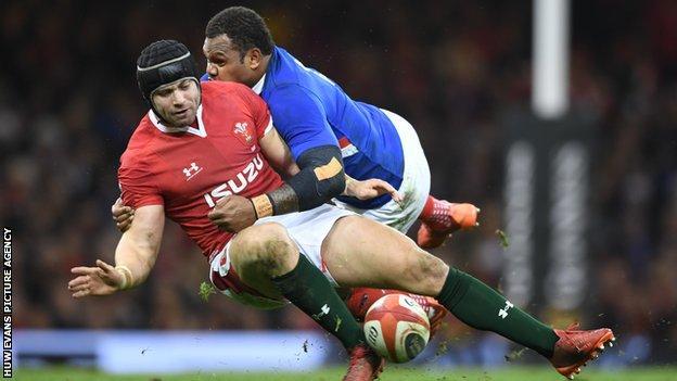 Wales' Leigh Halfpenny is tackled by Virimi Vakatawa