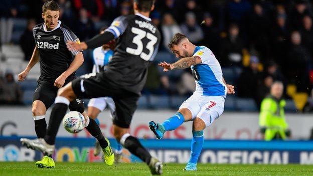Blackburn's Adam Armstrong scores against Derby