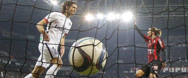 Edinson Cavani celebrates after putting Paris St-Germain ahead against Nice