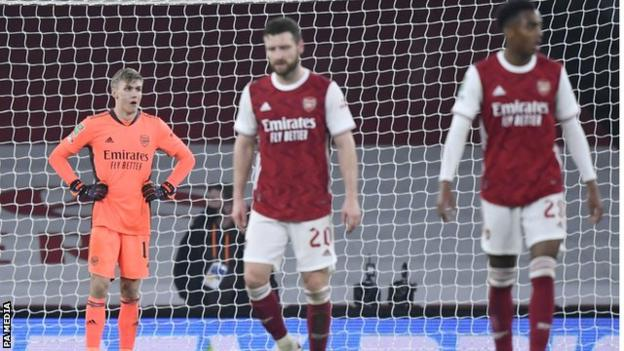 Arsenal's players reacts after conceding in the 4-1 defeat to Manchester City in the Carabao Cup