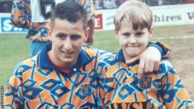 Dave Edwards (right) as a Shrewsbury Town mascot with former Shrews and Manchester City forward Carl Griffiths