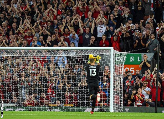 Adrian walks on to the Anfield pitc and is applauded by the home fans