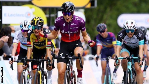 Dutch rider Demi Vollering (centre) celebrates winning the 2021 La Course