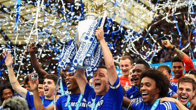 John Terry lifting the Premier League trophy