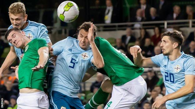 Republic of Ireland's Darragh Lenihan and Shane Duffy with George Saville, Jonny Evans and Craig Cathcart of Northern Ireland