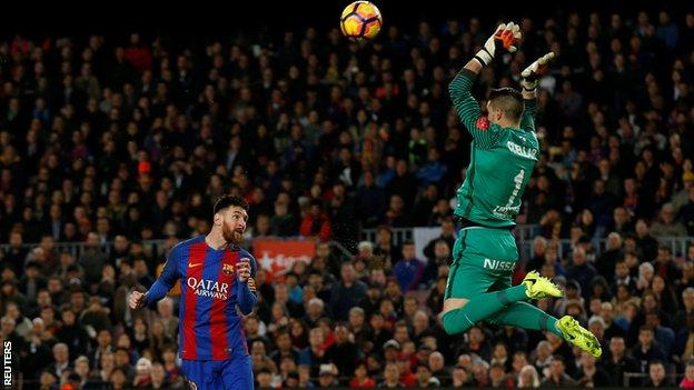 Lionel Messi heads Barcelona ahead against Sporting Gijon
