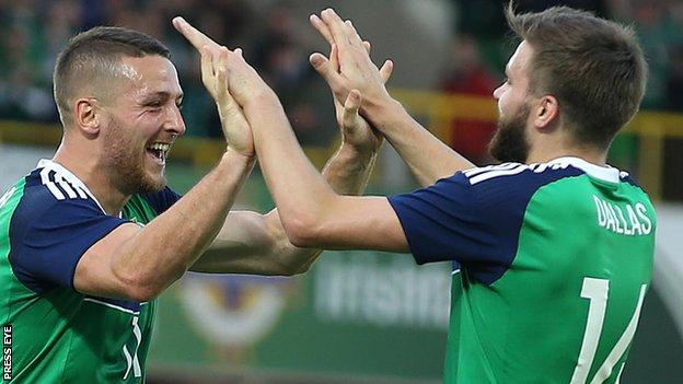 Conor Washington celebrates his goal against Belarus with NI team-mate Stuart Dallas