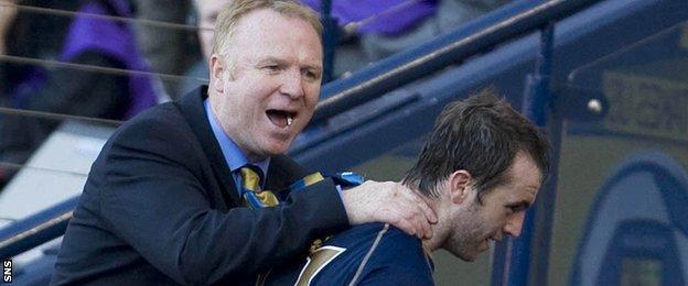 Alex McLeish congratulates James McFadden with Scotland