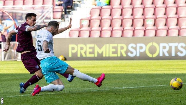 Jamie Walker scores