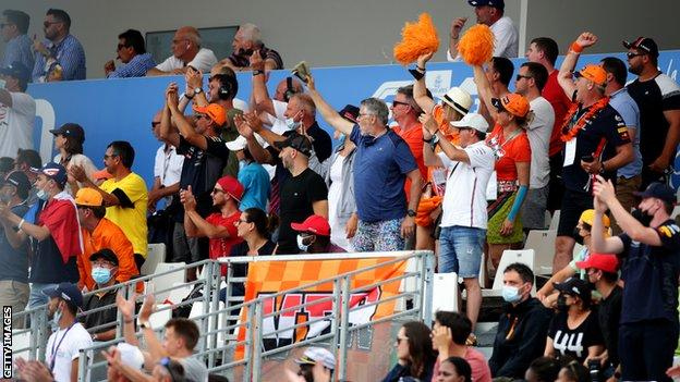 Max Verstappen fans, wearing orange cheer on the Dutch driver at the French Grand Prix