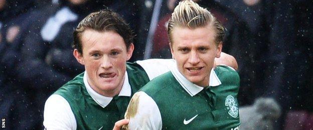 Liam Henderson (left) and Jason Cummings celebrate a Hibs goal