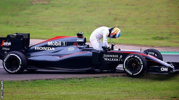 Fernando Alonso with broken down McLaren car at the 2015 Brazilian Grand Prix practice run
