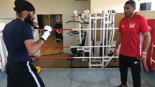 Karam Singh in the ring with trainer Wayne Elcock in Birmingham
