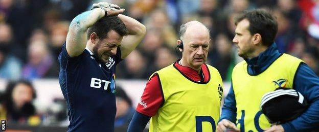 Scotland captain Greig Laidlaw is forced off injured