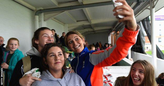 England captain Charlotte Edwards poses for a selfie with fans