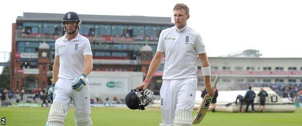 England's Jos Buttler and Joe Root walk off