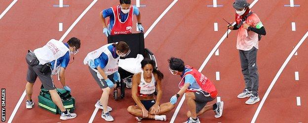 Katarina Johnson-Thompson is offered a wheelchair by doctors on the track