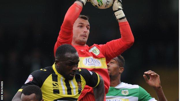 Yeovil goalkeeper Artur Krysiak collects a corner against Dagenham and Redbridge