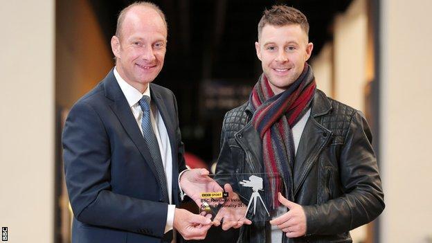 BBC Sport NI's Stephen Watson presents Jonathan Rea with his award