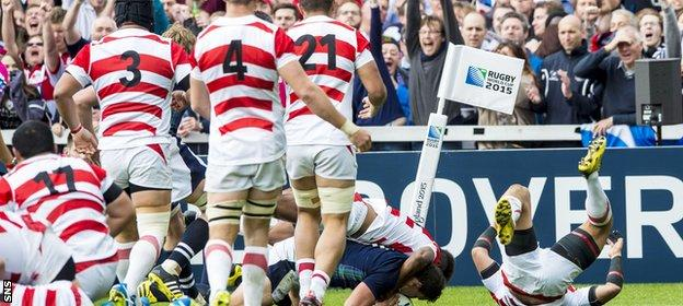 John Hardie (grounded) scores his try for Scotland