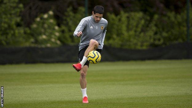 Pedro Neto practises with a football