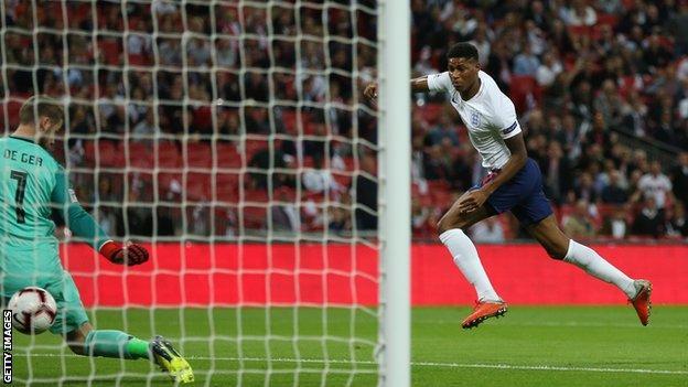 Marcus Rashford scores for England