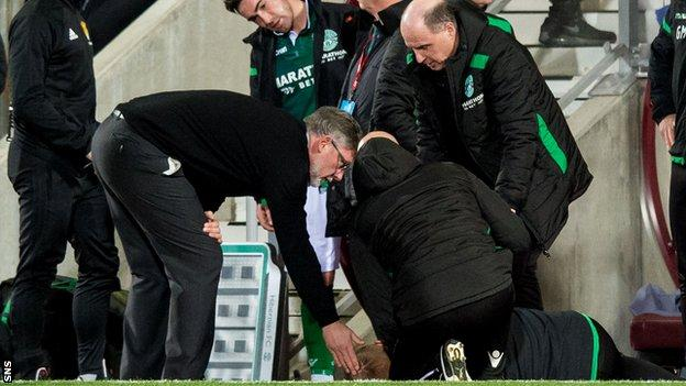 Hearts manager Craig Levein checks Neil Lennon's condition at Tynecastle