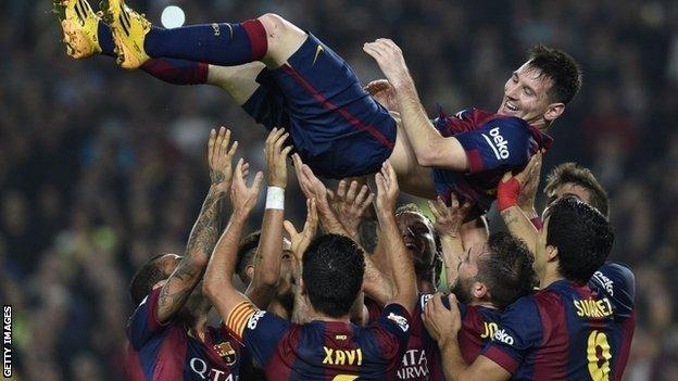 Lionel Messi is given bumps after breaking Barcelona's goalscoring record