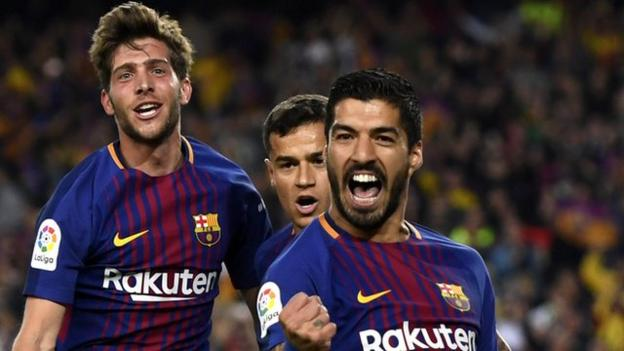 Luis Suarez celebrates scoring for Barcelona