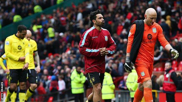 Aston Villa players walk off after being relegated at Old Trafford