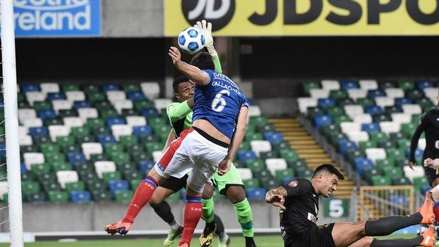 Linfield defender Jimmy Callacher is denied by Floriana keeper Ini Akpan